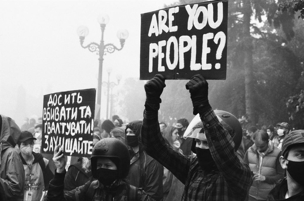 protest sign reads 'are you people'