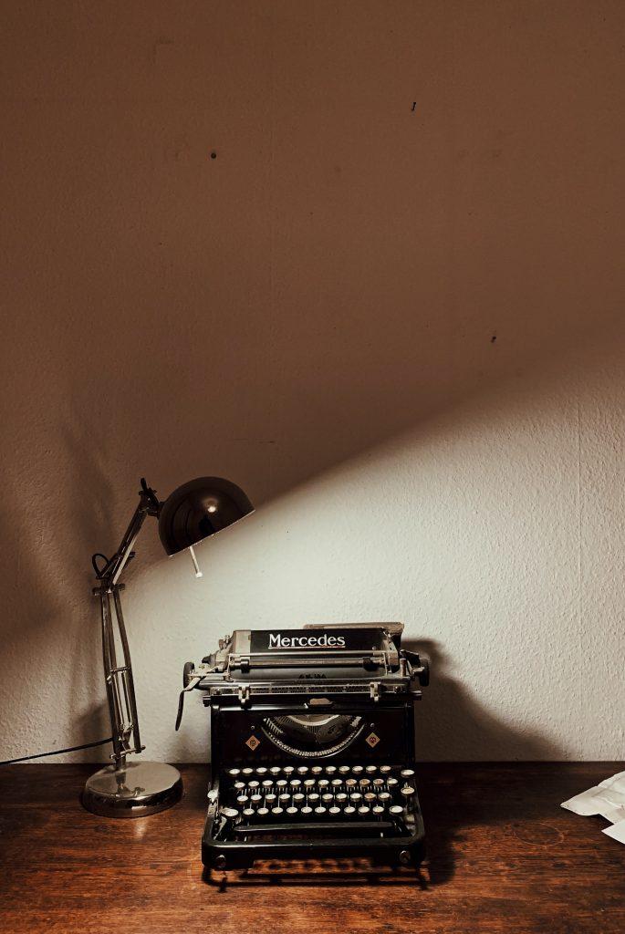 Desk lamp by typewriter